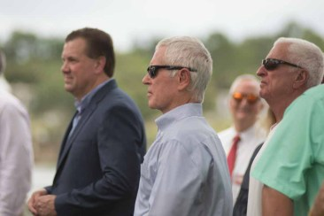 City officials at the unveiling included City Commissioner Michael Dunn, left, former Mayor Howard Wiggs, center, and former City Manager Gene Strickland.