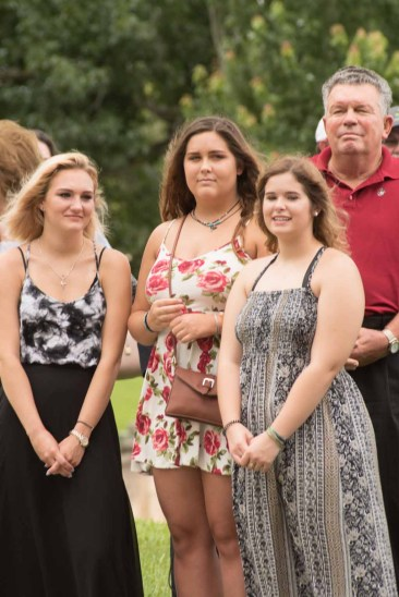 The artists who designed the tribute sculpture were Lakeland High School students Angel Rose Mitchell, Maddie McDaniel and Gabby Thomas. Looking on behind: former City Commissioner Don Selvage