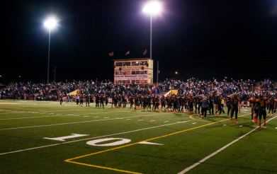Fans light up their cell phones, and players enter the field to wave at the patients at Carol Jenkins Barnett Pavilion for Women and Children which overlooks Bryant Stadium in a pause at the end of the first quarter.