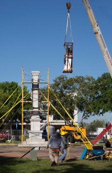 The statue is moved to the ground.