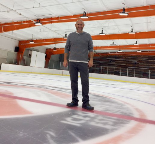 Paul Granville stands on the NHL-sized ice rink.