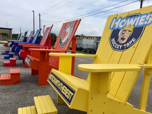 Outside the arena, Instagram-ready, oversize wooden chairs dot the parking lot.