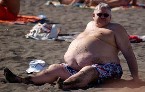 obese man on beach