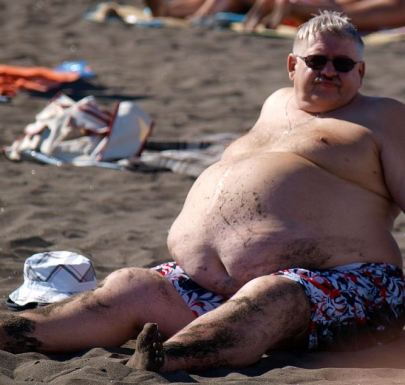 obese man on beach