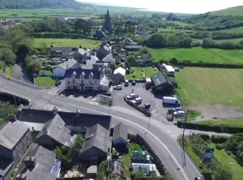 Aerial view of Llanrhystud including the Black Lion and Church