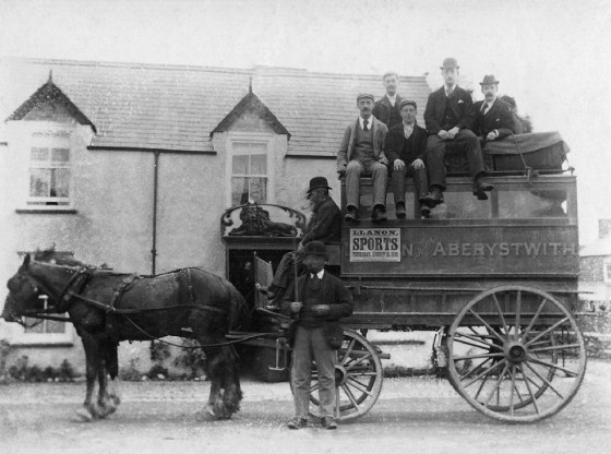 Early photo of a stagecoach outside the Red Lion Llanrhystyd