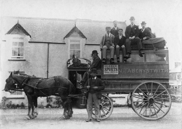 Early photo of a stagecoach outside the Red Lion, Llanrhystyd