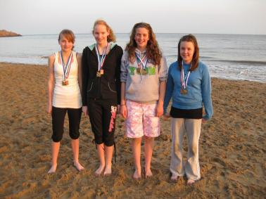 Llantwit Major Juniors with medals on Beach