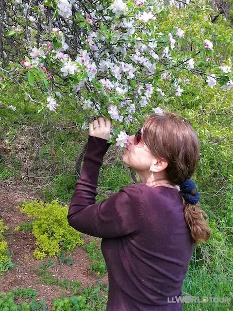 Lisa smells Flowers