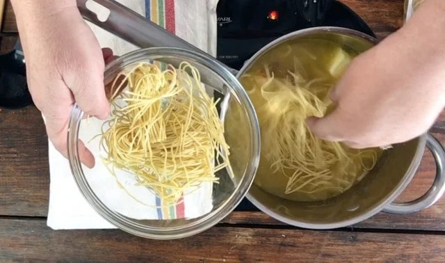 photo of adding more noodles to the soup