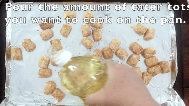 hand pouring vegetable oil on the baking sheet for cooking