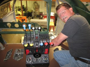 Wing Leader Dave McBride working on the controls of the AT-11
