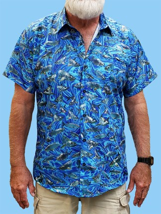 Men's dress shirt with many different photos of tarpon on a blue ocean swirl background