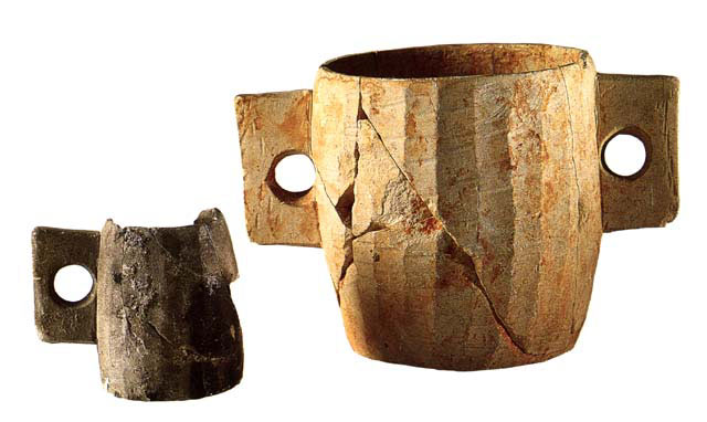 Limestone cup dating to the 1st C. CE. Cup (A): height 7.5 cm (3 in.), diameter 8 cm (3 1/8 in.) Cup (B): height 12.8 cm (5 in.), diameter 19.4 cm (7 1/2 in.) Courtesy of the Israel Antiquities Authority (38,39). Cylindrical cups of this type are frequently found in sites of the Second Temple Period. It is believed that their capacities correspond to the dry and liquid measures mentioned in the Mishnah, a collection of rabbinic laws governing all aspects of Jewish life.  The surfaces of these vessels were pared with a knife or adze, and their surface was left un-smoothed. The vertical handles rule out the possibility that they might have been produced on a rotating lathe. More at: http://www.loc.gov/exhibits/scrolls/art2.html