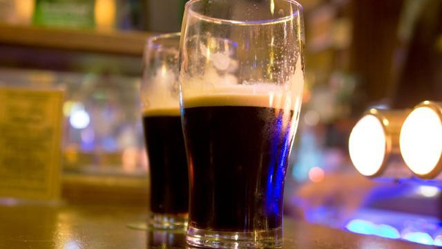 two pints of Guinness stout beer on bar_1696851092288639-159532