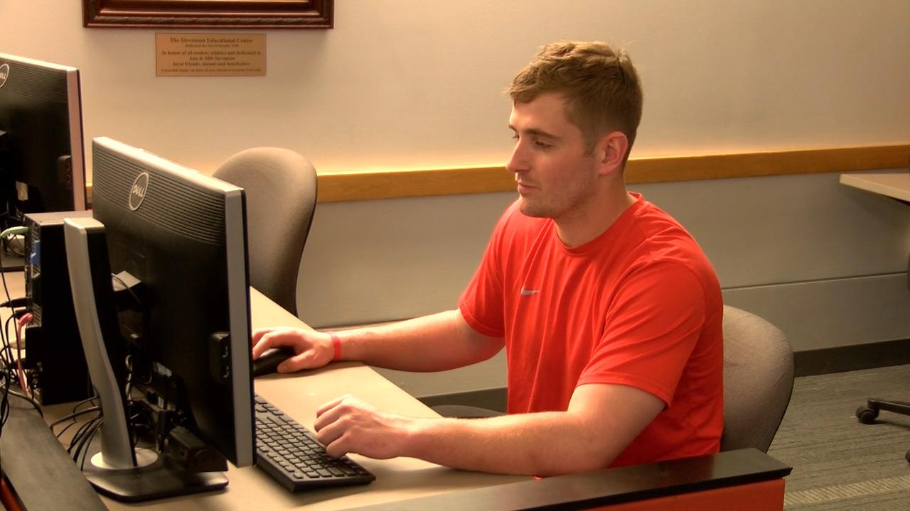 Marcus Cunningham at computer
