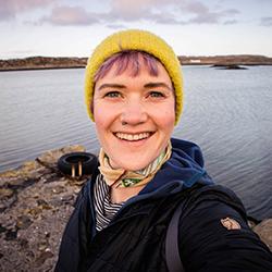kathi-kamleitner-wearing-a-yellow-hat-smiling