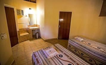 classic-accomodation-outlook-safaris-bungalow-interior.jpg