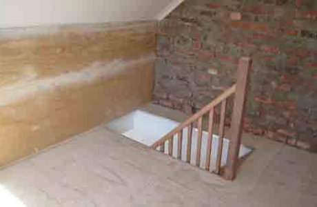 Wooden Staircase into roof storage space