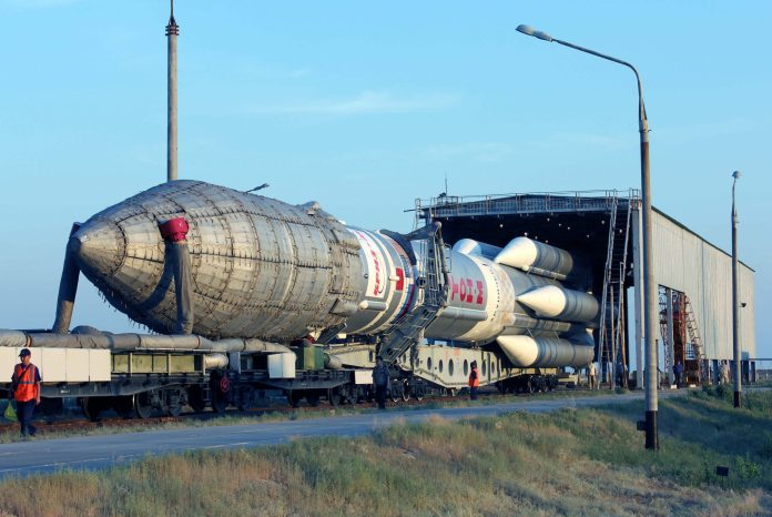 proton-m-space-launch-vehicle-with-an-upper-stage-breeze-m-spacecraft-and-communication-sirius-5-being-moved-to-the-launch-pad-at-baikonur-cosmodrome