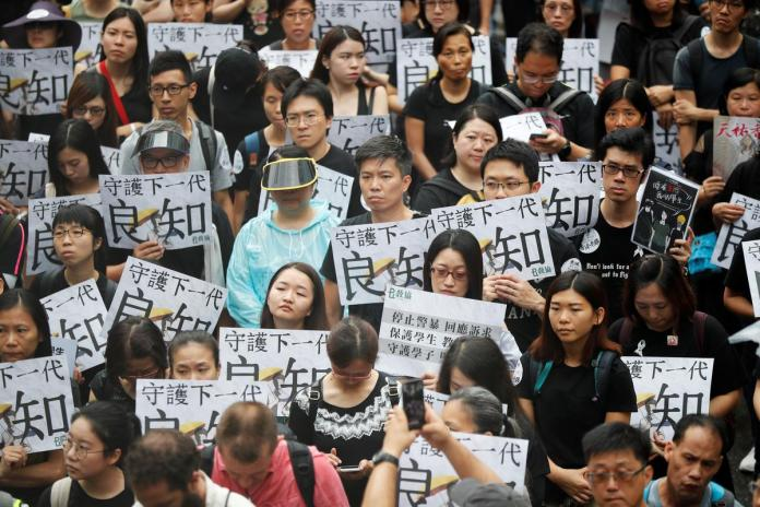 [NEWS] Hong Kong teachers rally in thunderstorm at start of weekend of protests – Loganspace AI