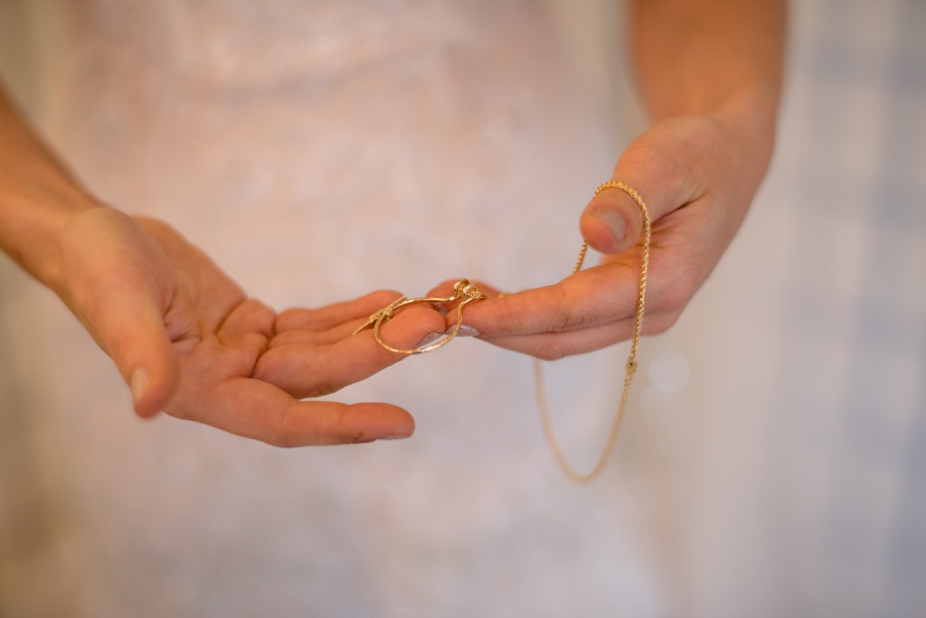 bride holding necklace
