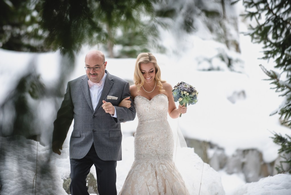 bride and father walking in the winter