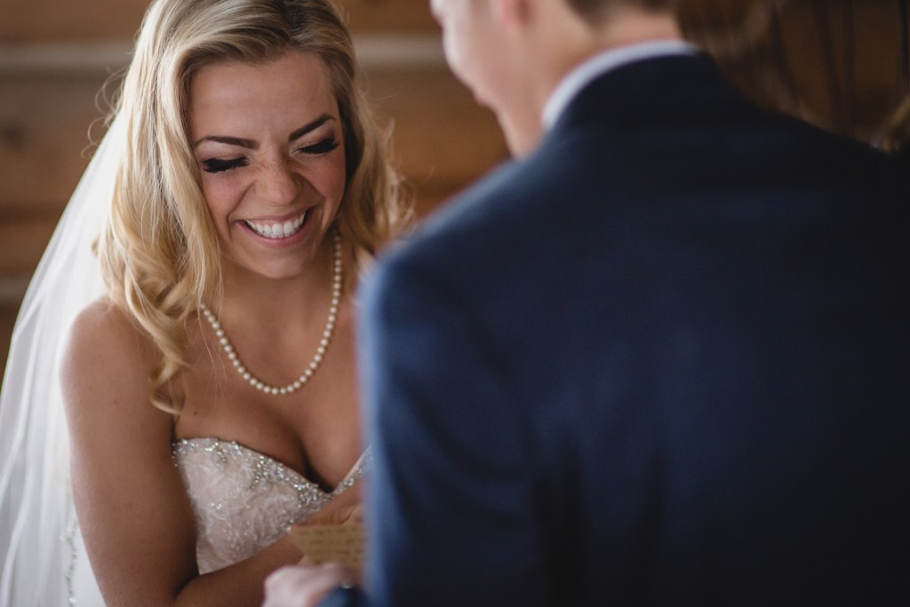 bride laughing at her ceremony