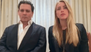 Actor Johnny Depp and his wife Amber Heard, apologizing ineffectively for violating Australia's no-pet law
