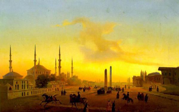 Veduta della piazza dell'ippodromo di Costantinopoli con cavalli e cavalieri in primo piano; sullo sfondo obelischi e la Moschea Blu avvolti nella luce del tramonto