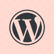 WordPress logo on top of a pink polka-dot background image