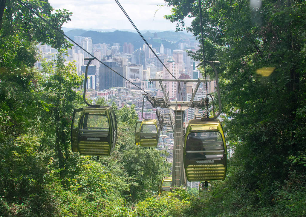 Qianling Park in Guiyang China - cable car with view of the city below
