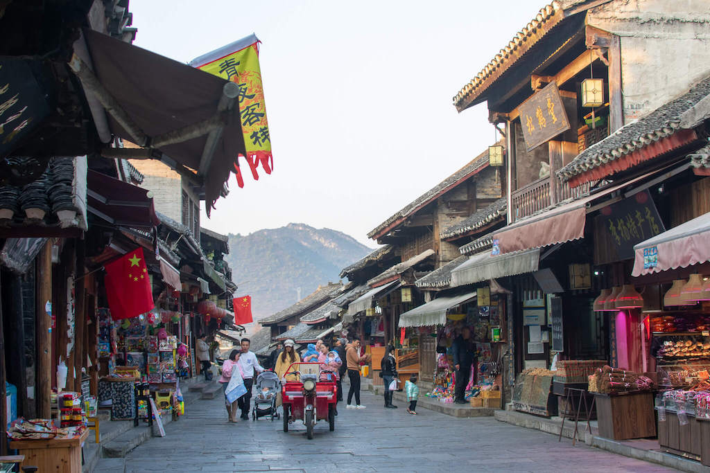 Qingyan Ancient Town in Guiyang, street with ancient Chinese buildings filled with people