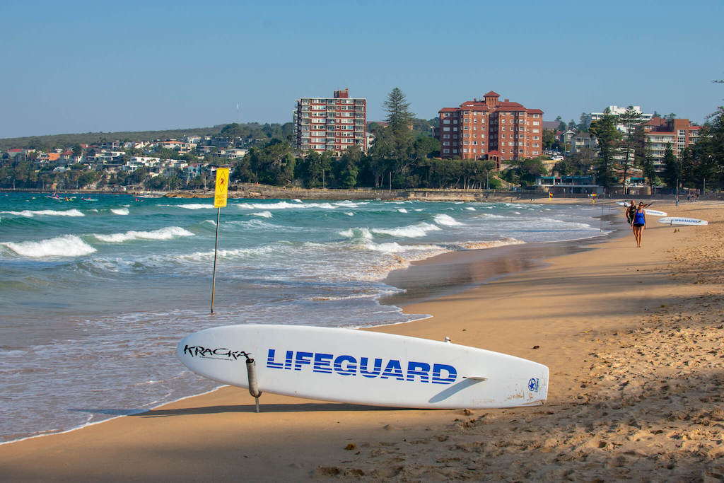 Sydney Manley Beach with ocean and lifeguard surfboard