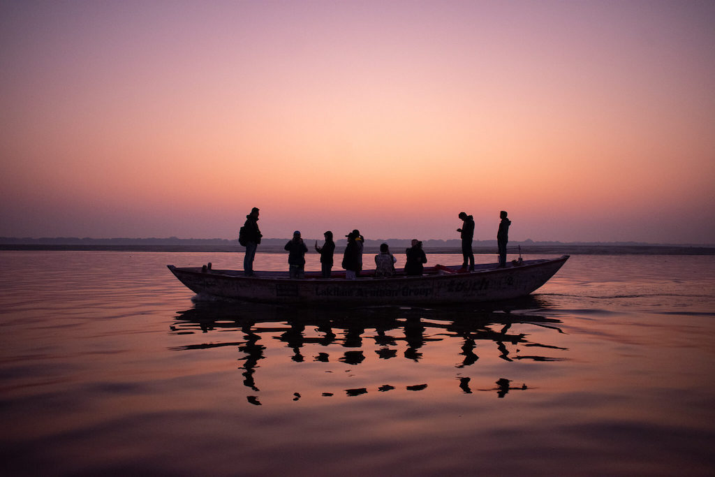 Pink sunset on the Ganga River in Varanasi, Northern India