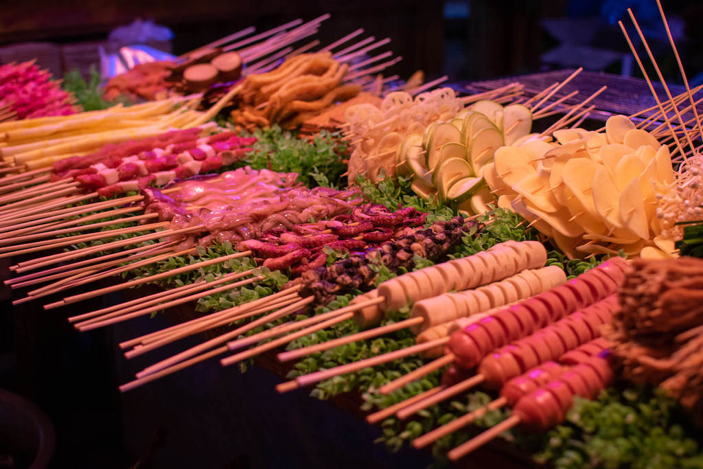 Lots of different skewers at a street food stall in China