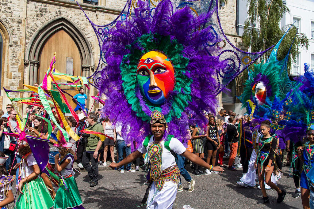 Man in colourful costume at Notting Hill Carnival London