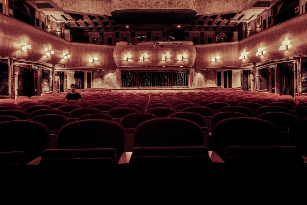 London theatre interior with empty red seats