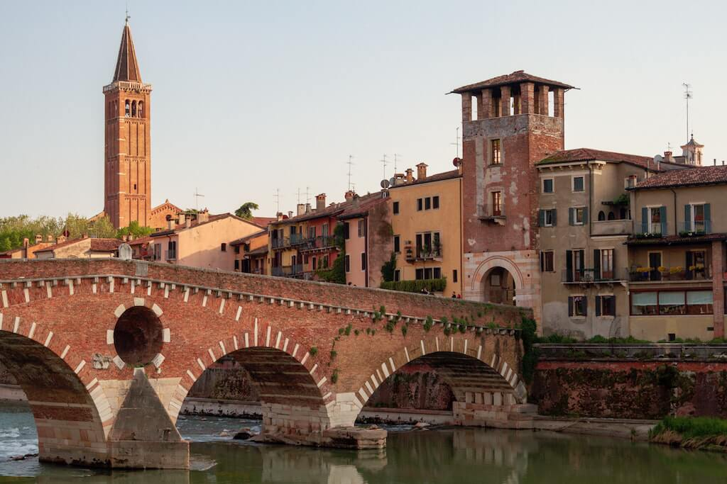 Ponte Pietra over the Adige River and historic buildings in Verona