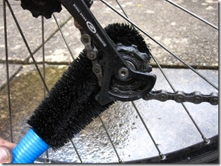 Cleaning bike picture of brush in rear mech