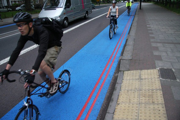 Three cyclists on a blue cycle superhighway