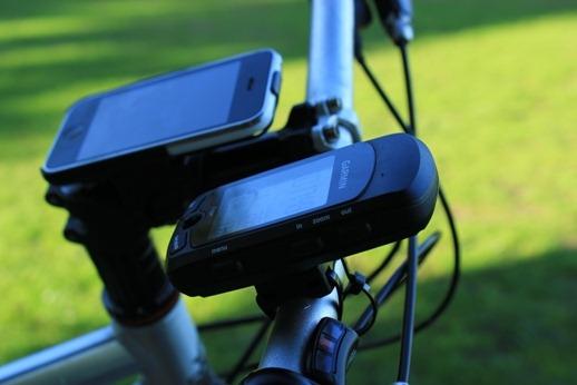 Garmin gps next to the iPhone on bicycle handlebars