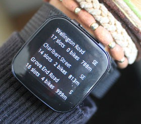Cycle hire gadget on the display screen of the live view strapped to a wrist