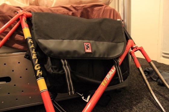 Chrome Buran laptop messenger bag holding a red raleigh frame