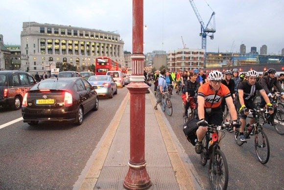 Cyclists on the right side of Blackfriars and motorists on the other