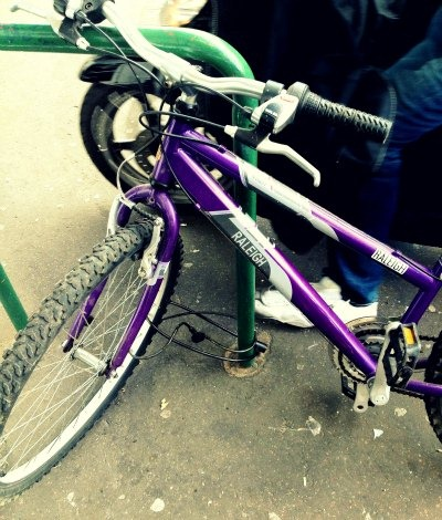 One bicycle lock around front wheel only