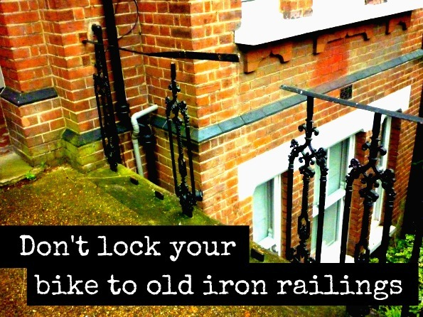 Picture showing iron railings that have been cut by thieves to remove a bike