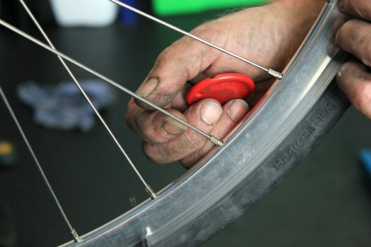 Plucking the bike wheel spokes