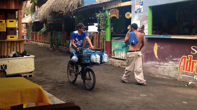 Cyclist rides past in El Salvador
