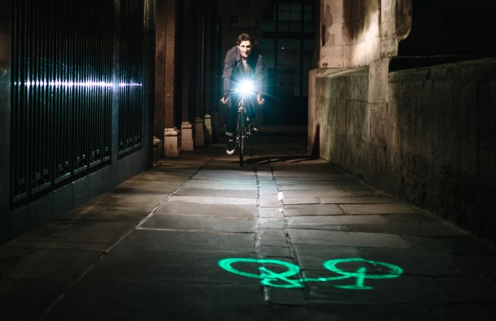 Cyclist using blaze laserlight on street